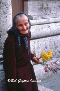 Lady with Flowers, Perugia, Italy by Bob Grytten